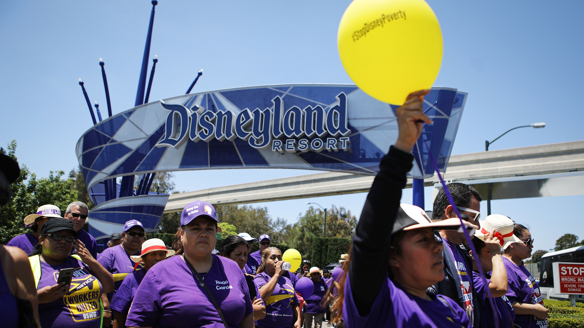 Disneyland workers and supporters march while protesting low pay and calling for a living wage at the Disneyland entrance on July 3, 2018 in Anaheim. (Credit: Mario Tama/Getty Images)