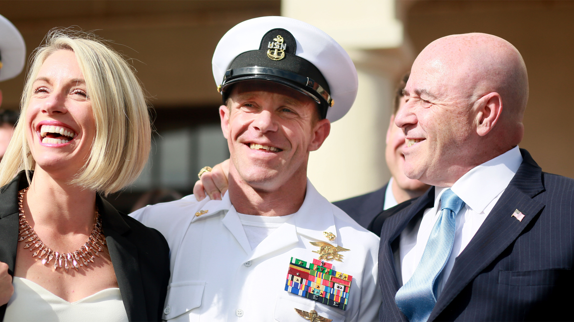 Navy Special Operations Chief Edward Gallagher celebrates with his wife Andrea after being acquitted of premeditated murder at Naval Base San Diego July 2, 2019, in San Diego. (Credit: Sandy Huffaker/Getty Images)