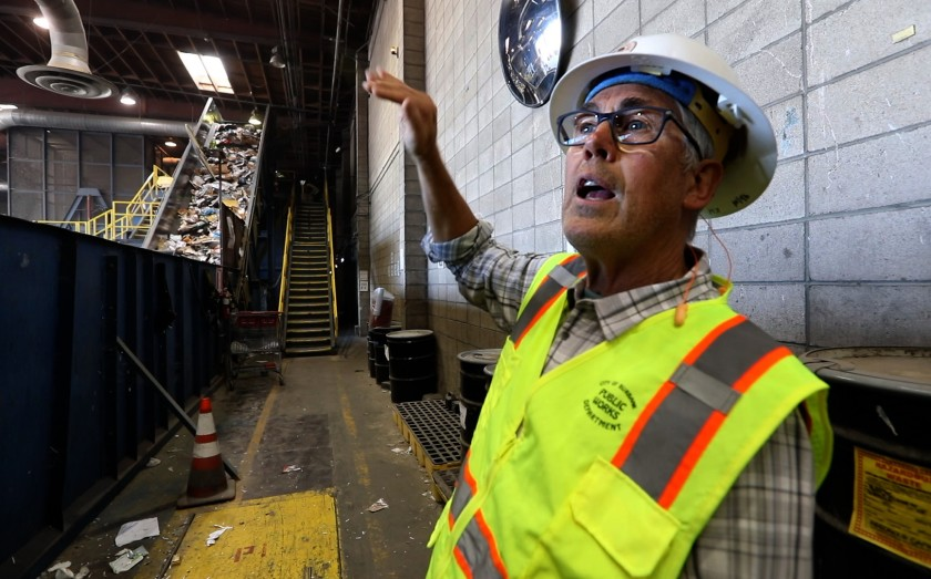 """""""We just don't have a market for a lot of this stuff,"""" said Kreigh Hampel, recycling coordinator for the city of Burbank. The California recycling industry has struggled after China stopped accepting certain kinds of recycled materials. (Credit: Carolyn Cole / Los Angeles Times)"""