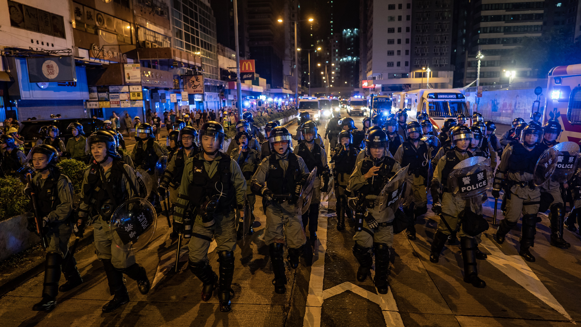Riot police charge outside of the Mongkok Police Station during a standoff with protesters after an anti-government rally in on September 1, 2019 in Hong Kong, China. (Credit: Anthony Kwan/Getty Images)