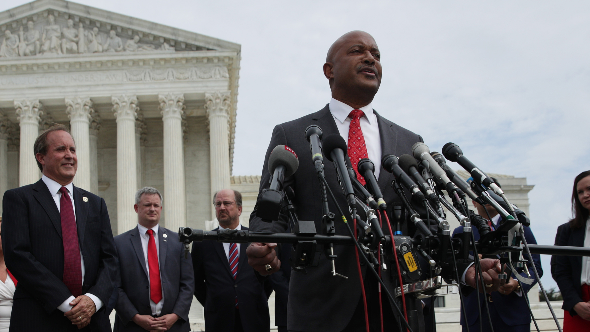 Indiana Attorney General Curtis Hill speaks as Washington, D.C. Attorney General Karl Racine (L) and Texas Attorney General Ken Paxton (2nd L) listen during a news conference in front of the U.S. Supreme Court Sept. 9, 2019, in Washington, D.C. (Credit: Alex Wong/Getty Images)