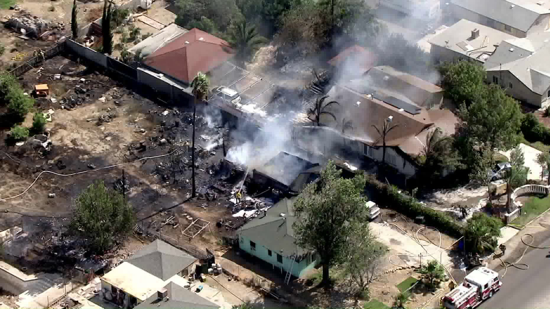 A wind-driven blaze in Fontana burned multiple homes on Oct. 10, 2019. (Credit: KTLA)
