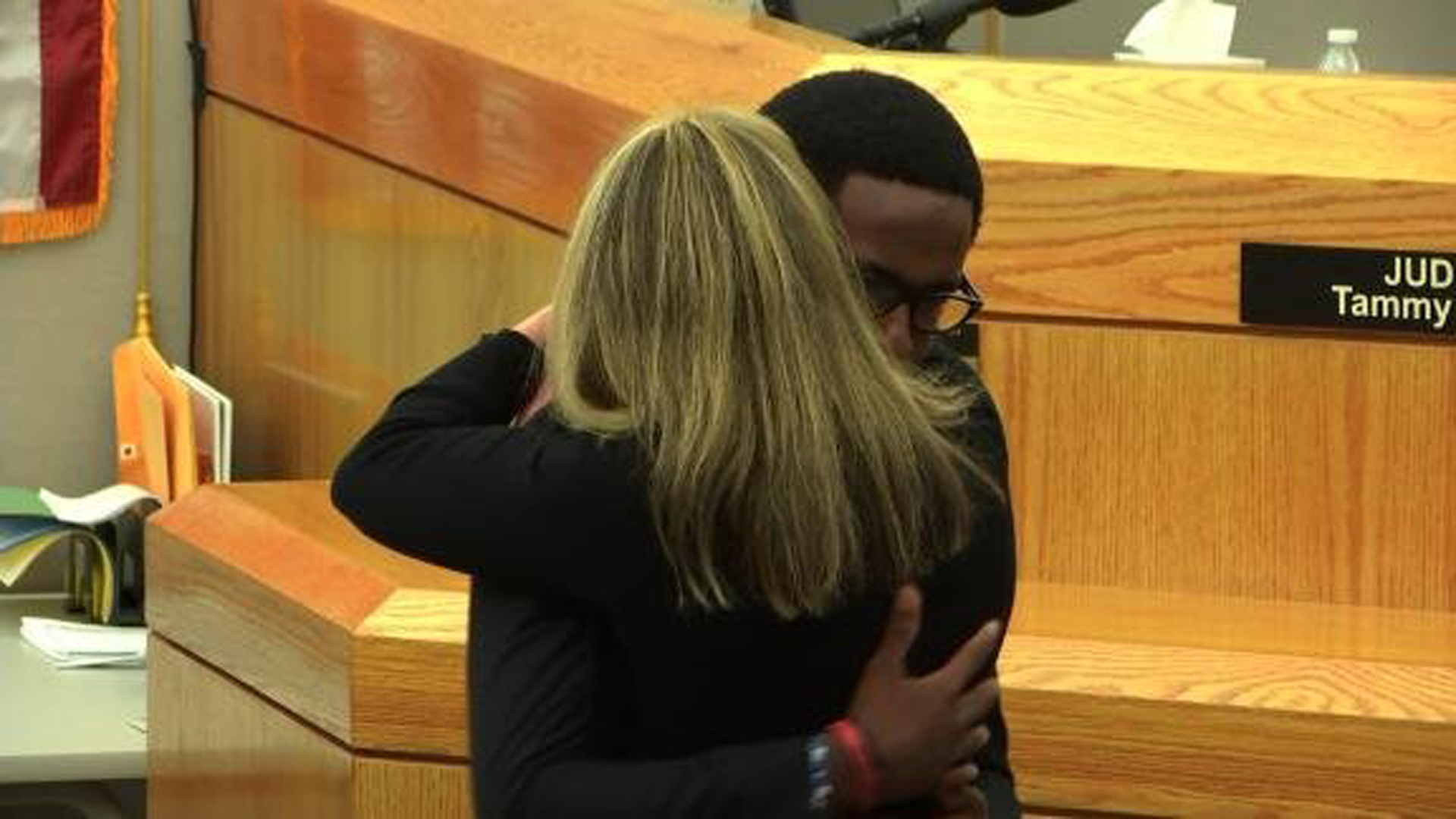 After a jury sentenced former Dallas Police Officer Amber Guyger to 10 years in prison for the murder of Botham Jean, his brother gave her a hug after giving a statement on Oct. 2, 2019. (Credit: KTVT)