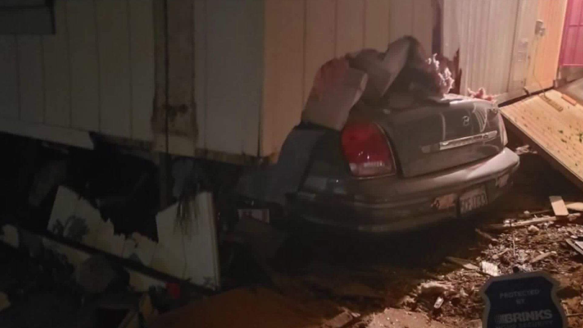 A car remains stuck under a mobile home after the driver slammed into it on Nov. 4, 2019. (Photo courtesy of Zack Holst)