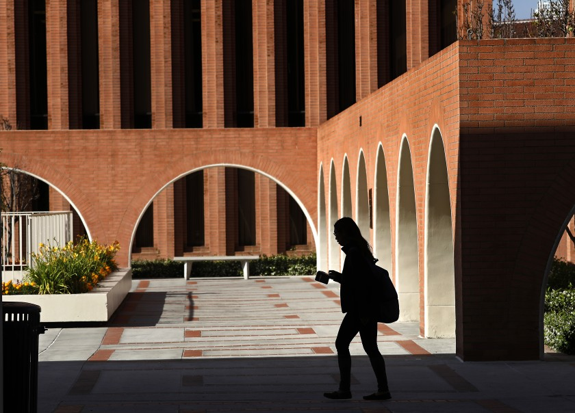 A student makes her way on the USC campus near the Barbara and Roger Rossier School of Education in this undated photo. (Mel Melcon/Los Angeles Times)