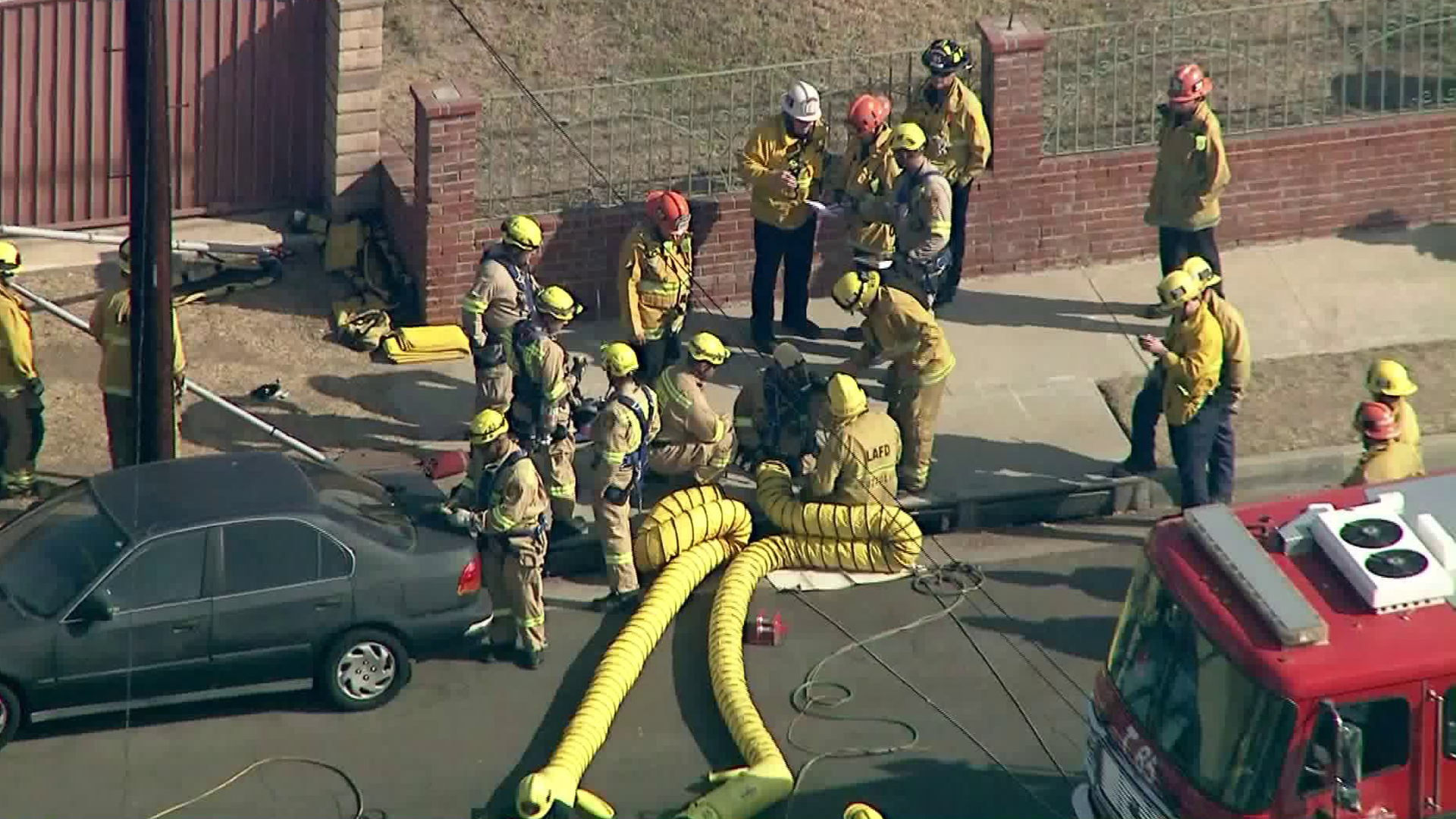 The Los Angeles Fire Department worked on extricating an individual stuck in a sewer pipe in Wilmington on Nov. 7, 2019. (Credit: Sky5)