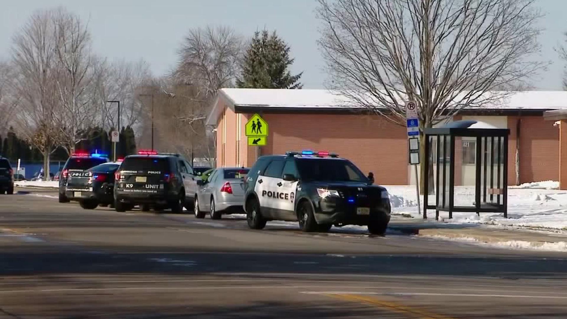 Police vehicles are seen outside Oshkosh West High School in Oshkosh, Wisconsin, on Dec. 3, 2019. (Credit: WITI)