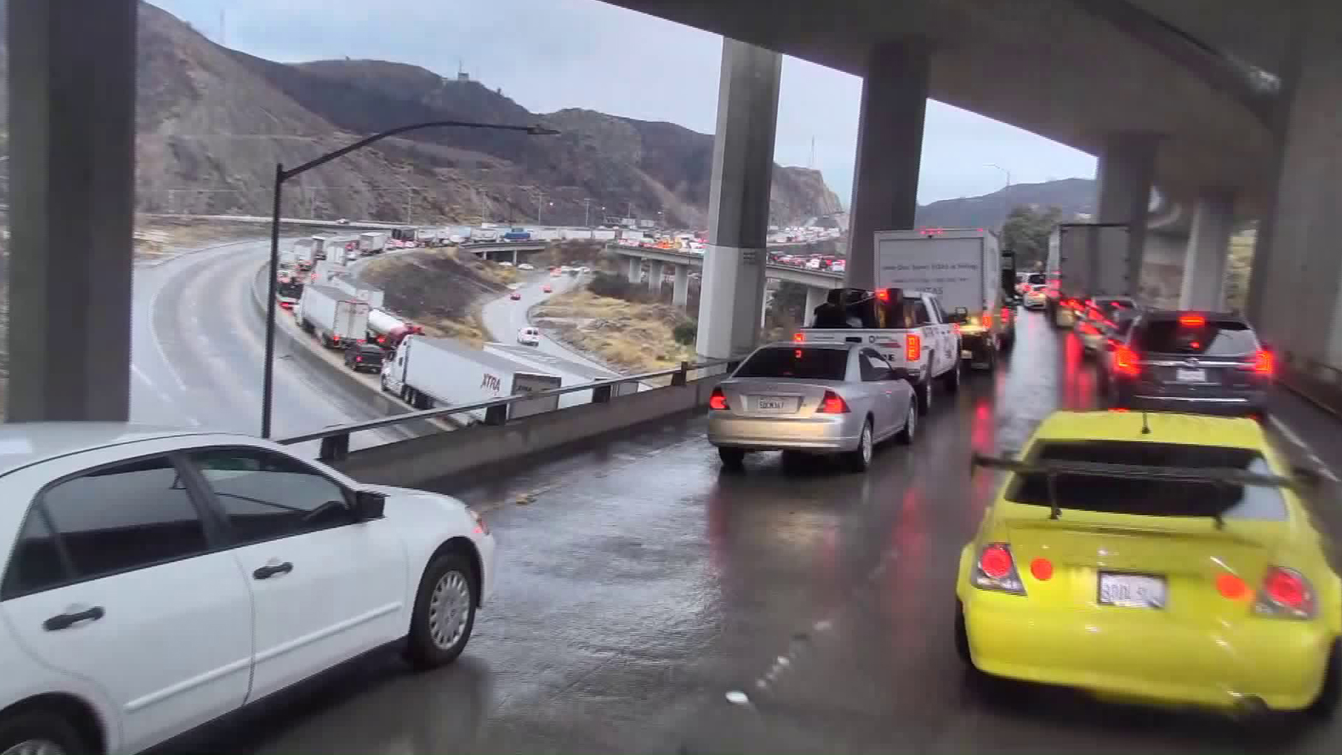 Commuters go through the 5 Freeway in the Sylmar area as rain pounded Southern California on Dec. 4, 2019. (Credit: KTLA)