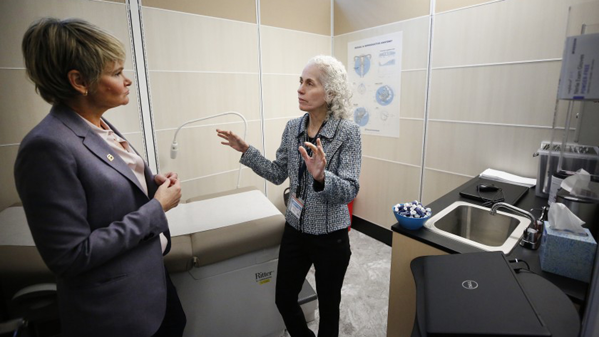 Sue Dunlap, left, president and CEO of Planned Parenthood Los Angeles, talks with Barbara Ferrer, the L.A. County public health director, as they tour the new sexual healthcare center at Esteban Torres High School in East L.A.(Credit: Al Seib / Los Angeles Times)