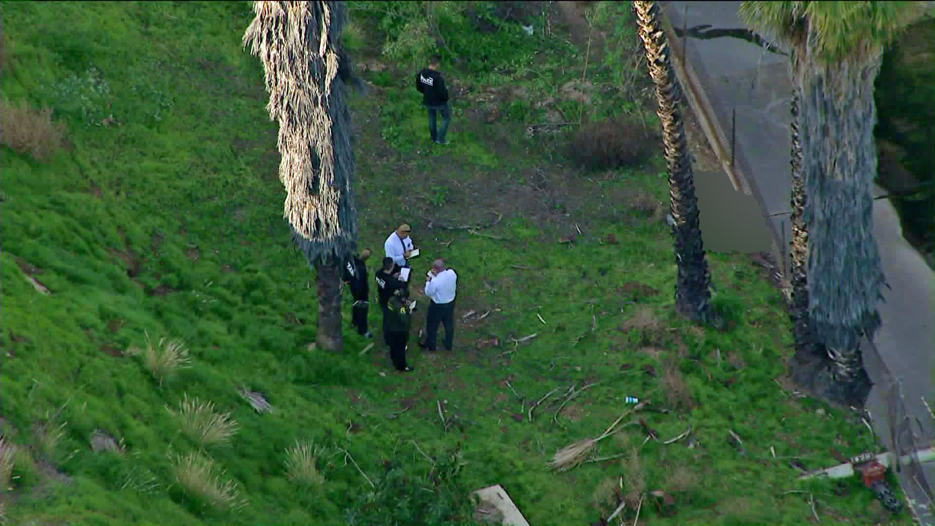 Authorities investigate the circumstances the death of a woman who was found near Almansor Park in Alhambra on Jan. 17, 2020. (Credit: KTLA)