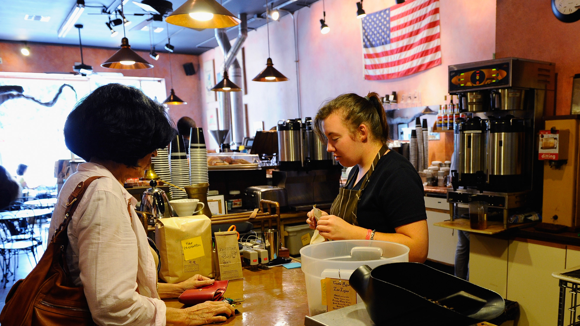 A customer buys a cup of coffee at a family-owned roasting coffeehouse in Culver City, California on Sept. 8, 2010. (Credit: Kevork Djansezian/Getty Images)