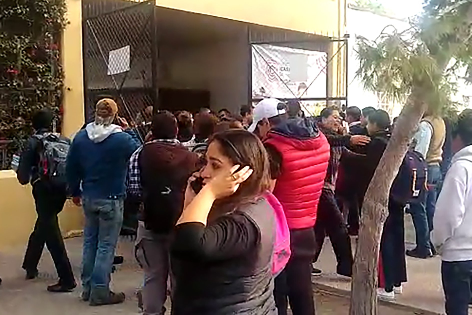 A video grab from AFP TV shows relatives of students outside of a school in Torreon, Coahuila state, Mexico, where a shooting occurred on Jan. 10, 2020. (Credit: STR/AFPTV/AFP via Getty Images)