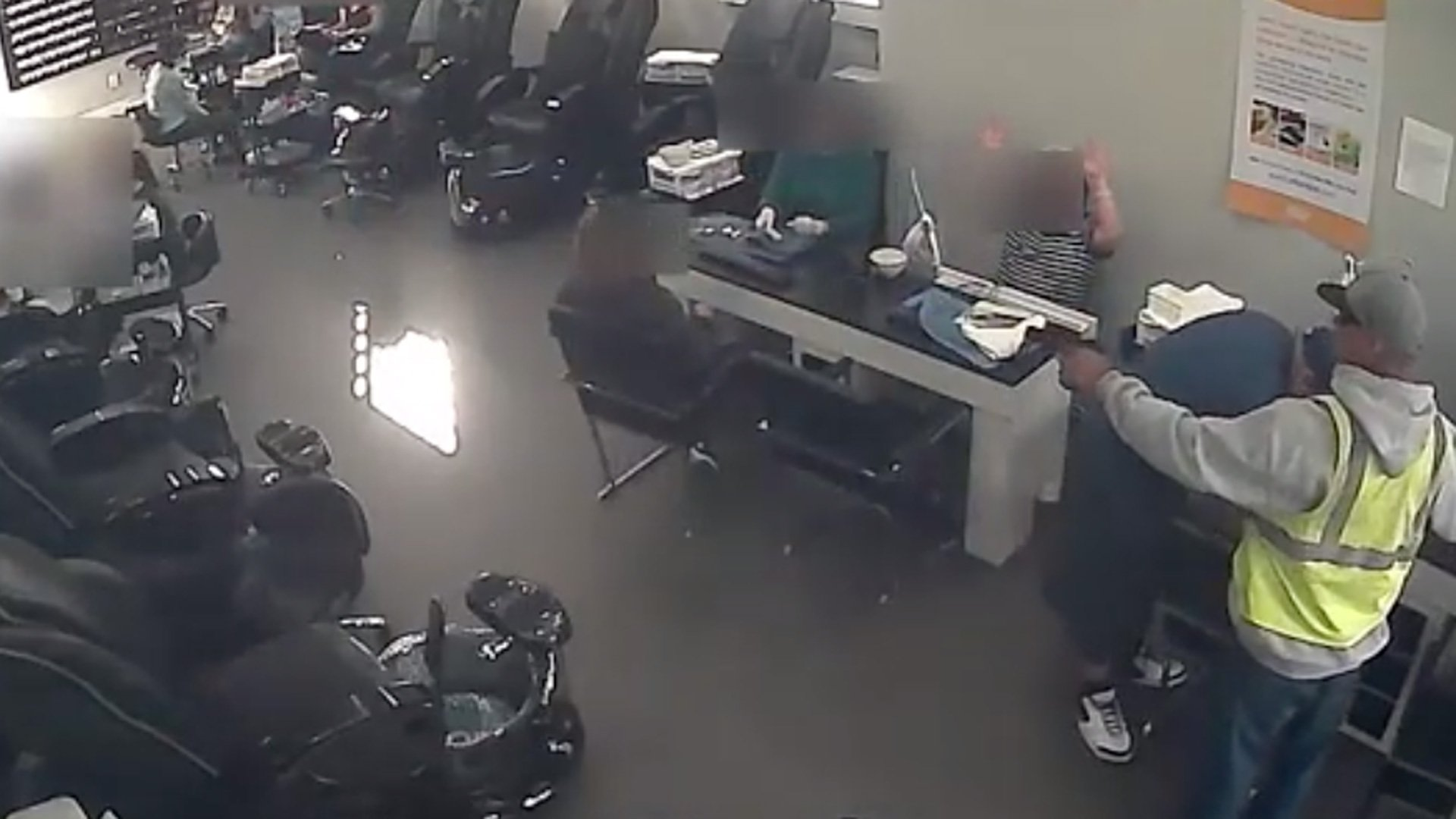 LAPD released surveillance video from inside a nail salon that was robbed on Nov. 21, 2019. (Credit: LAPD)