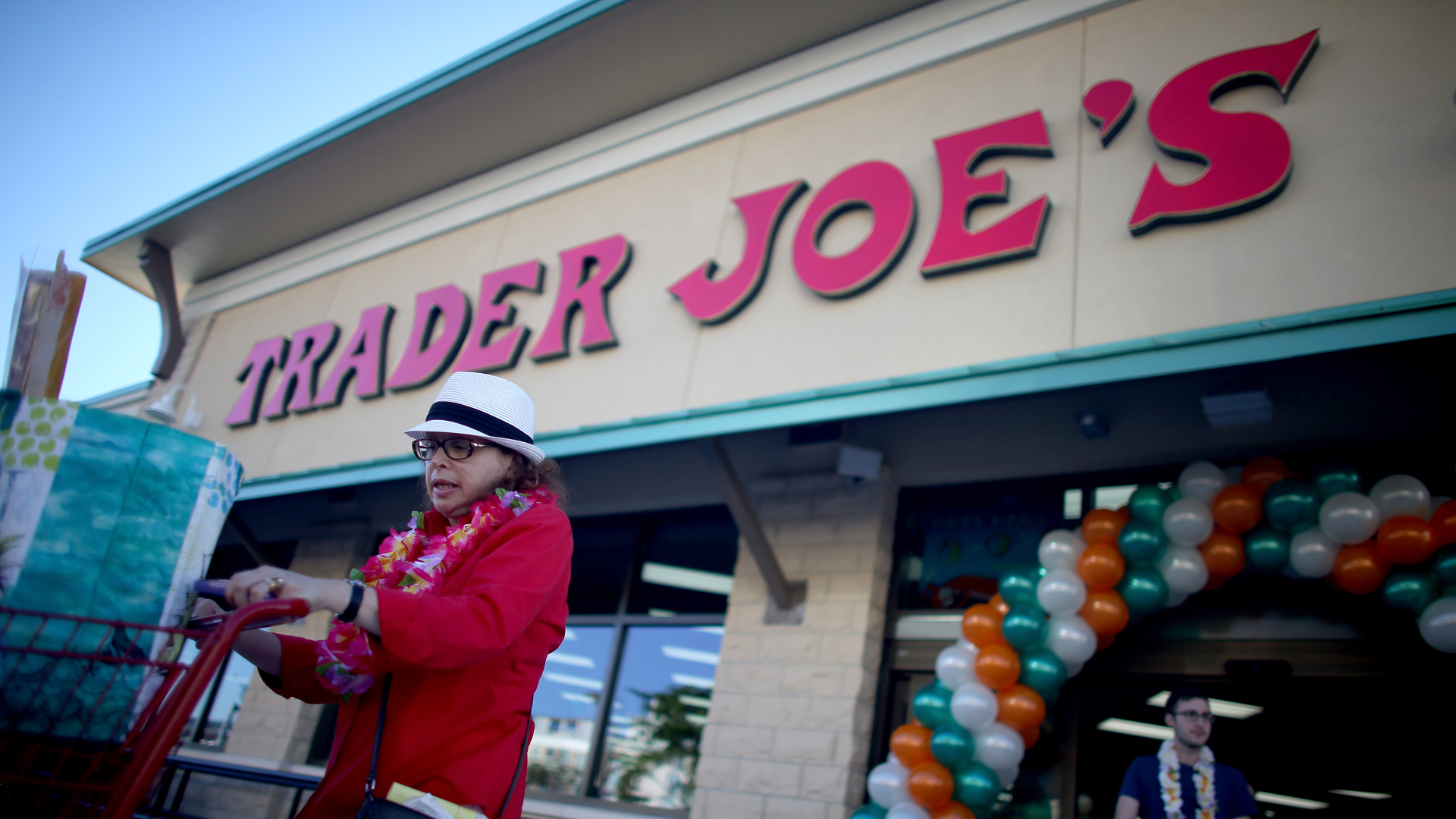 Helaine Goodner exits with her groceries after shopping at the grand opening of a Trader Joe's on October 18, 2013 in Pinecrest, Florida. (Credit: Kena Betancur/Getty Images)