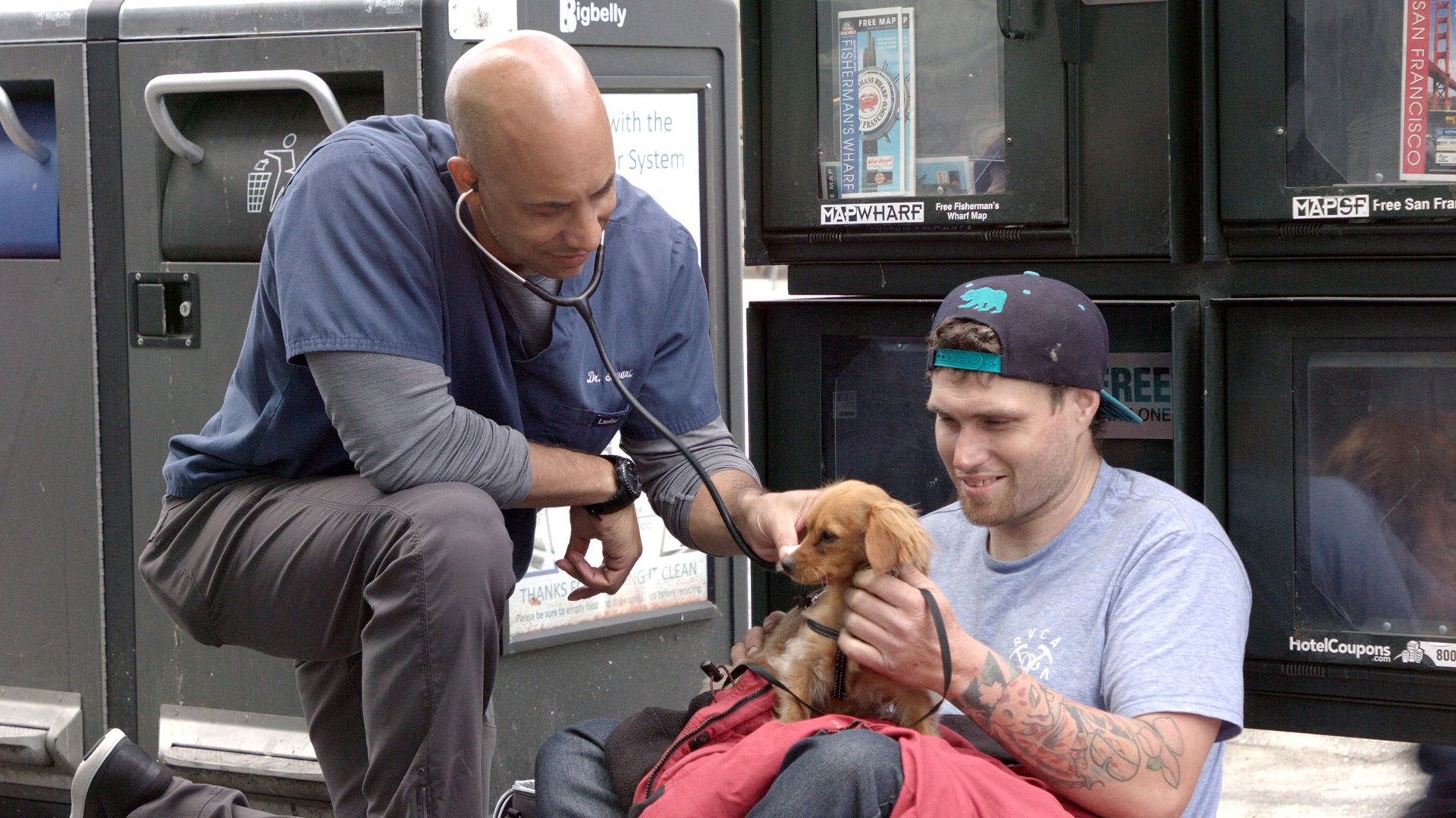 Kwane Stewart treating a man's dog. (The Street Vet/Two Sons Productions)