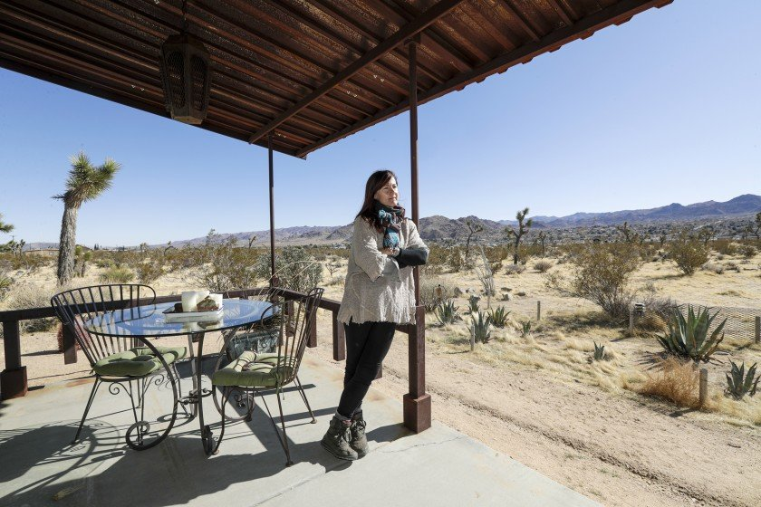 Amanda B'Hymer, who owns a vacation home in Joshua Tree, says she's wary of San Bernardino County's stepped-up code enforcement of hundreds of its short-term rental homes, which under a new ordinance must be inspected in order to get a permit to continue operating. The number of these rentals has exploded 21% over the last year alone.(Credit: Irfan Khan / Los Angeles Times)