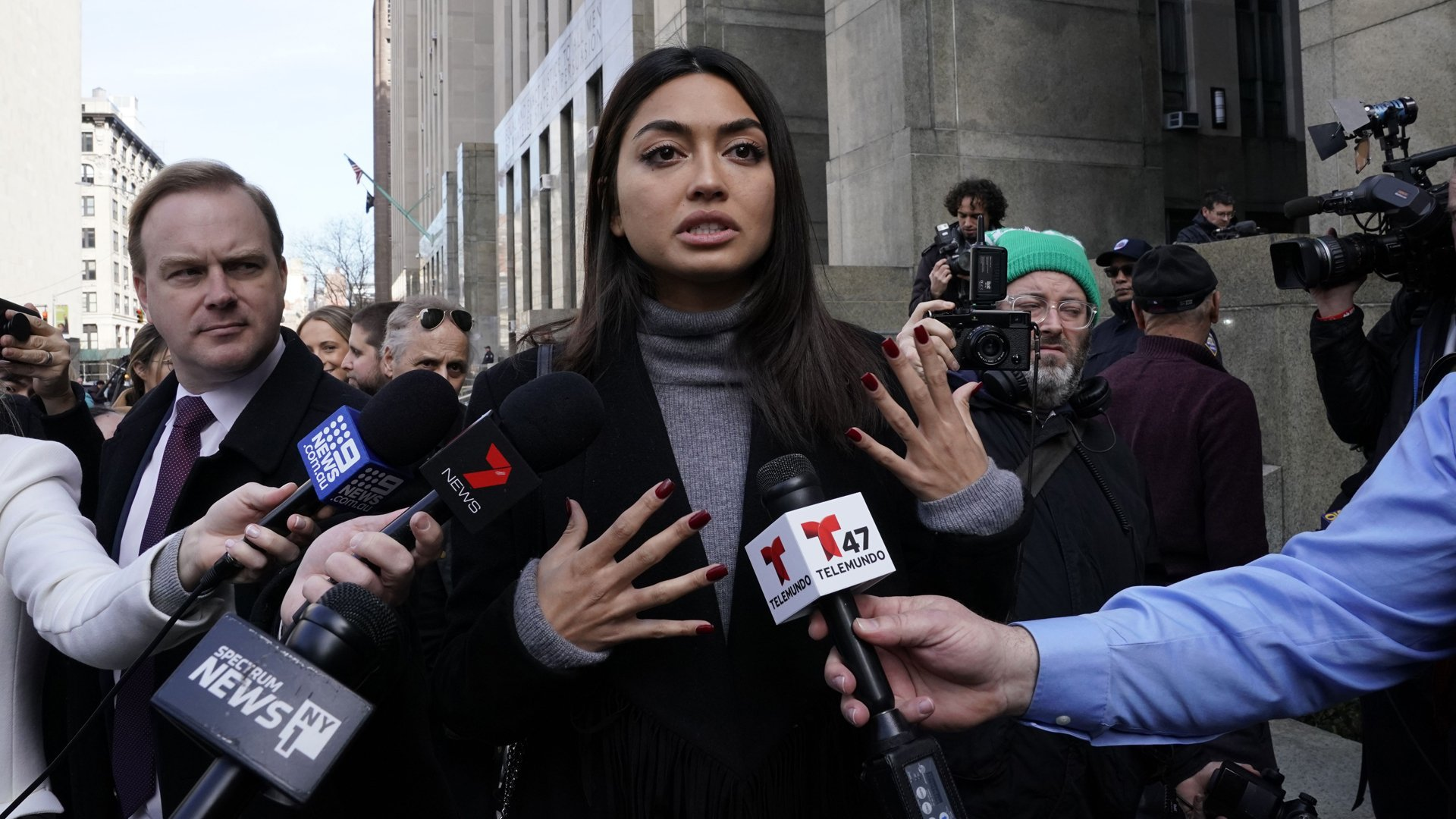 Ambra Battilana Gutierrez, an Italian-Filipina model who signed a million-dollar nondisclosure agreement with Harvey Weinstein, talks to press outside the Manhattan criminal courthouse after the producer was convicted on Feb. 24, 2020. (Credit: Timothy A. Clary / AFP / Getty Images)