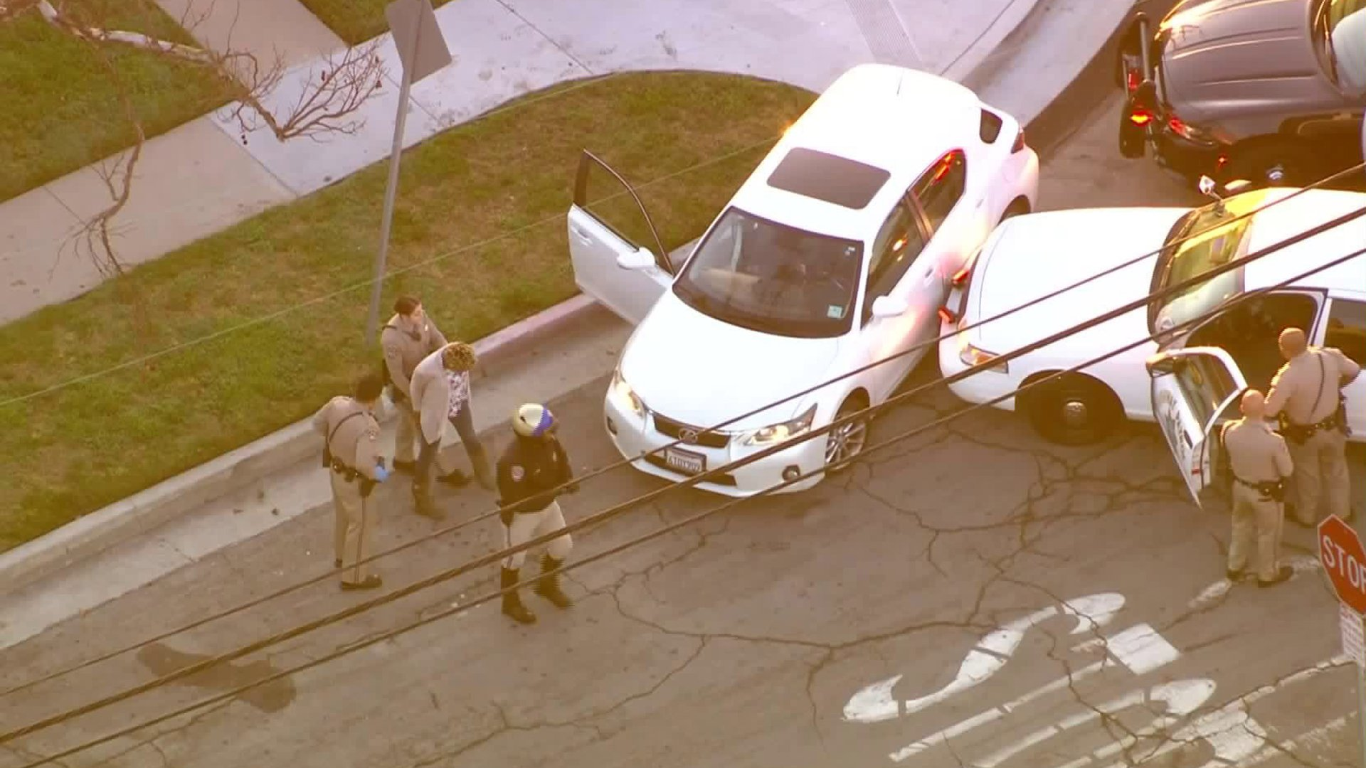 Officers detain a driver in Long Beach following a pursuit on Feb. 11, 2020. (Credit: Sky5)