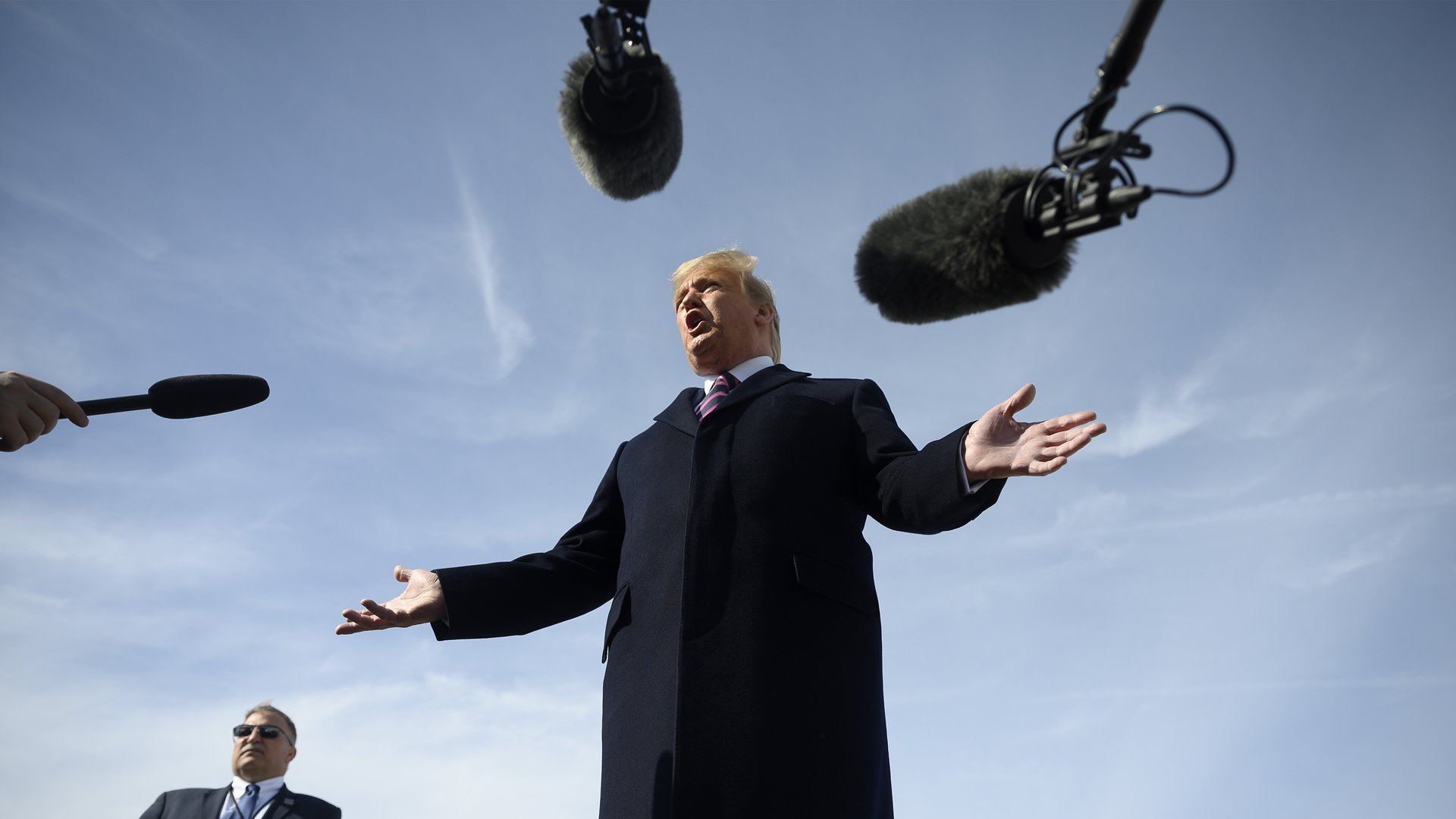 President Donald Trump speaks to the press before boarding Air Force One at Join Base Andrews in Maryland, en route to Los Angeles, on Feb. 18, 2020. (Credit: Jim Watson / AFP / Getty Images)