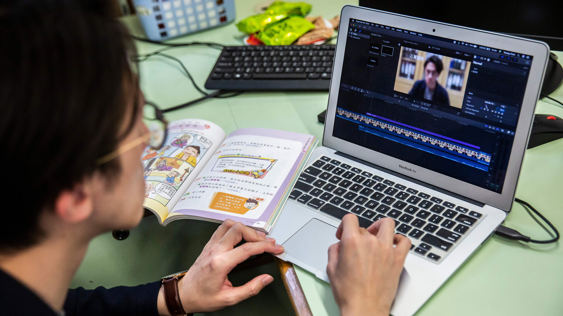 In this photo taken on March 6, 2020, primary school teacher Billy Yeung edits a video lesson he recorded in an empty classroom, for his students who have had their classes suspended due to the COVID-19 coronavirus, in Hong Kong. (Isaac Lawrence/AFP/Getty Images)