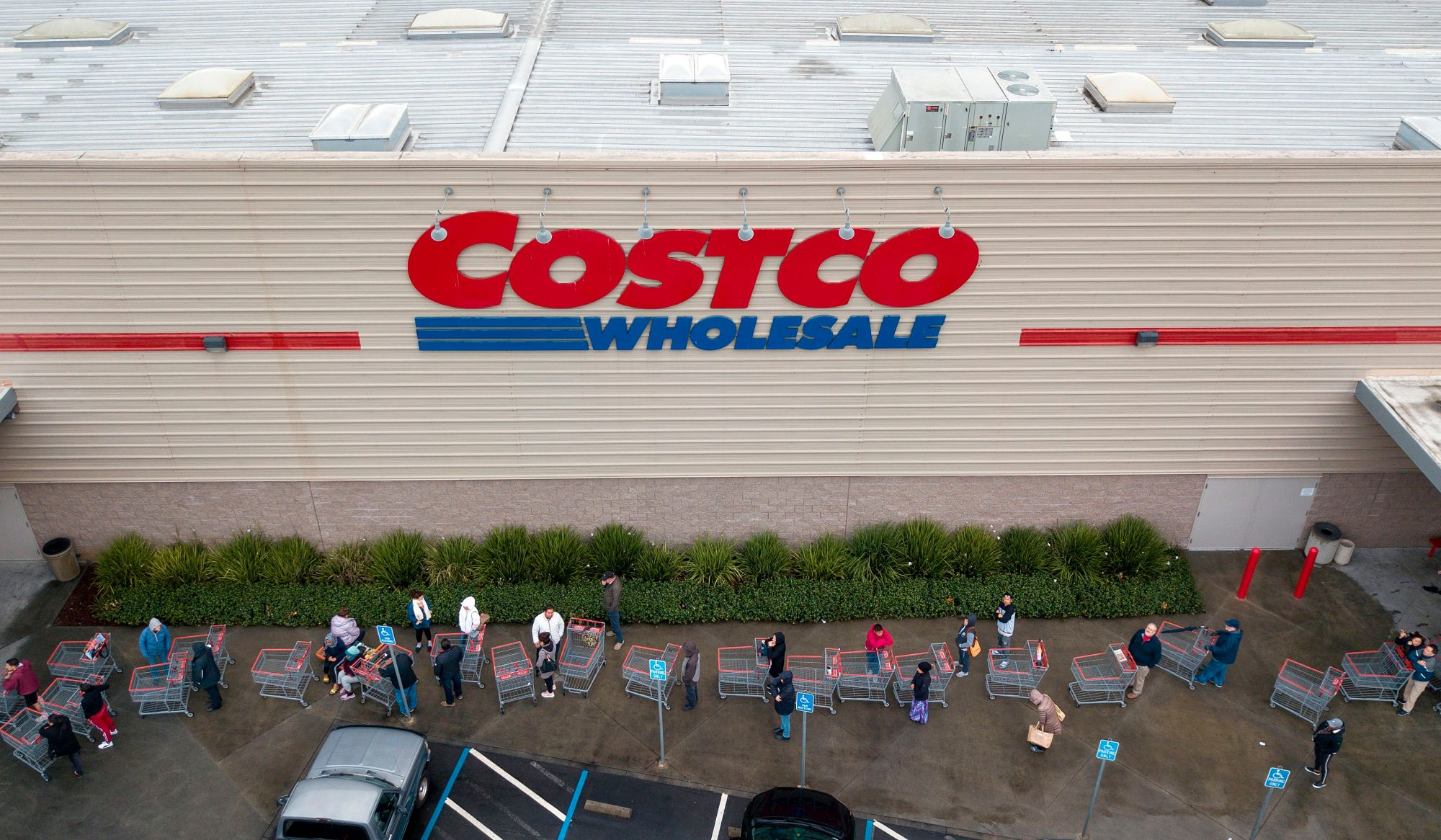 A line of shoppers snakes around a Costco store in Novato, California on March 14, 2020. (Josh Edelson/AFP via Getty Images)