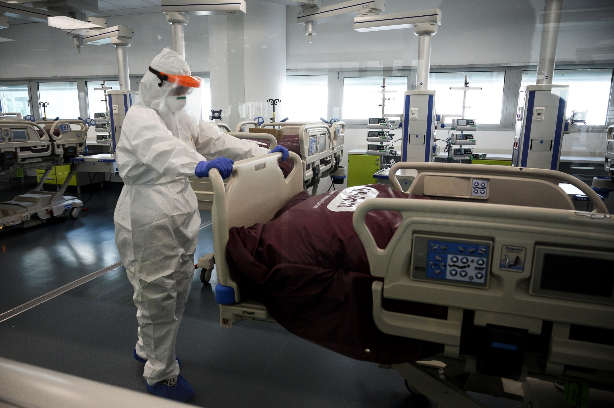 A nurse works to prepare the Intensive Care Unit in the new COVID-19 hospital on March 29, 2020, in Verduno, near Alba, northwestern Italy on the eve of its official opening, as part of the measures taken to fight against the spread of the novel coronavirus. (MARCO BERTORELLO/AFP via Getty Images)