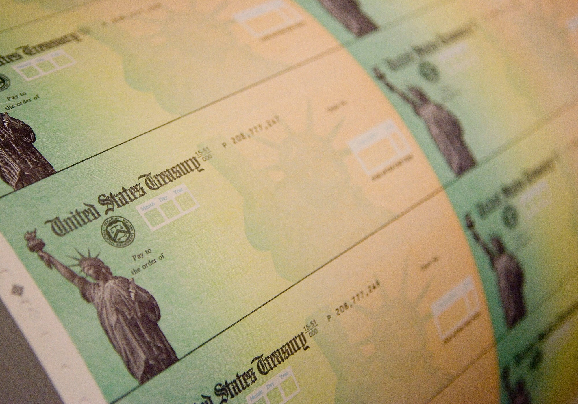 Economic stimulus checks are prepared for printing at the Philadelphia Financial Center May 8, 2008 in Philadelphia, Pennsylvania. One hundred and thirty million households are eligible to receive a tax rebate check under the $168 billion economic stimulus plan. (Jeff Fusco/Getty Images)