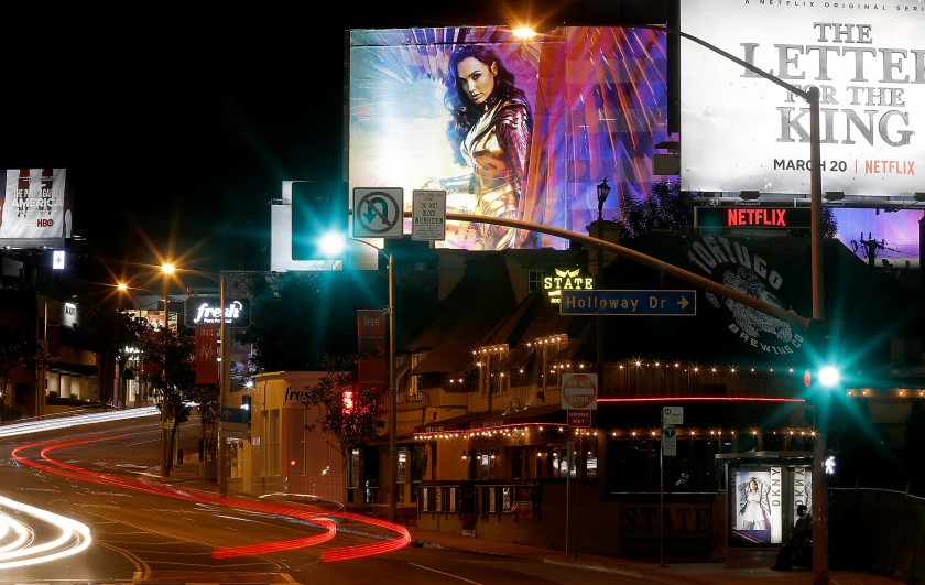 West Hollywood's Sunset Strip is seen largely devoid of motor and pedestrian traffic on March 19, 2020. (Luis Sinco / Los Angeles Times)