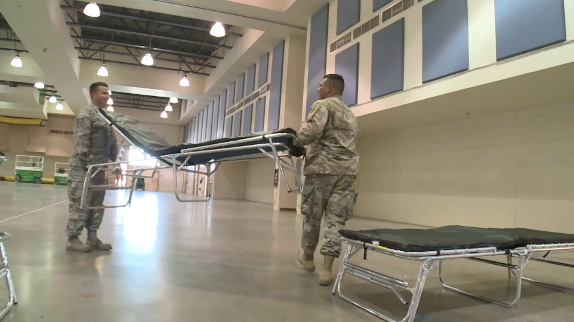 California National Guard troops use federal supplies to set up a temporary hospital at the Riverside County Fairgrounds in Indio on March 25, 2020. (Credit: KTLA)