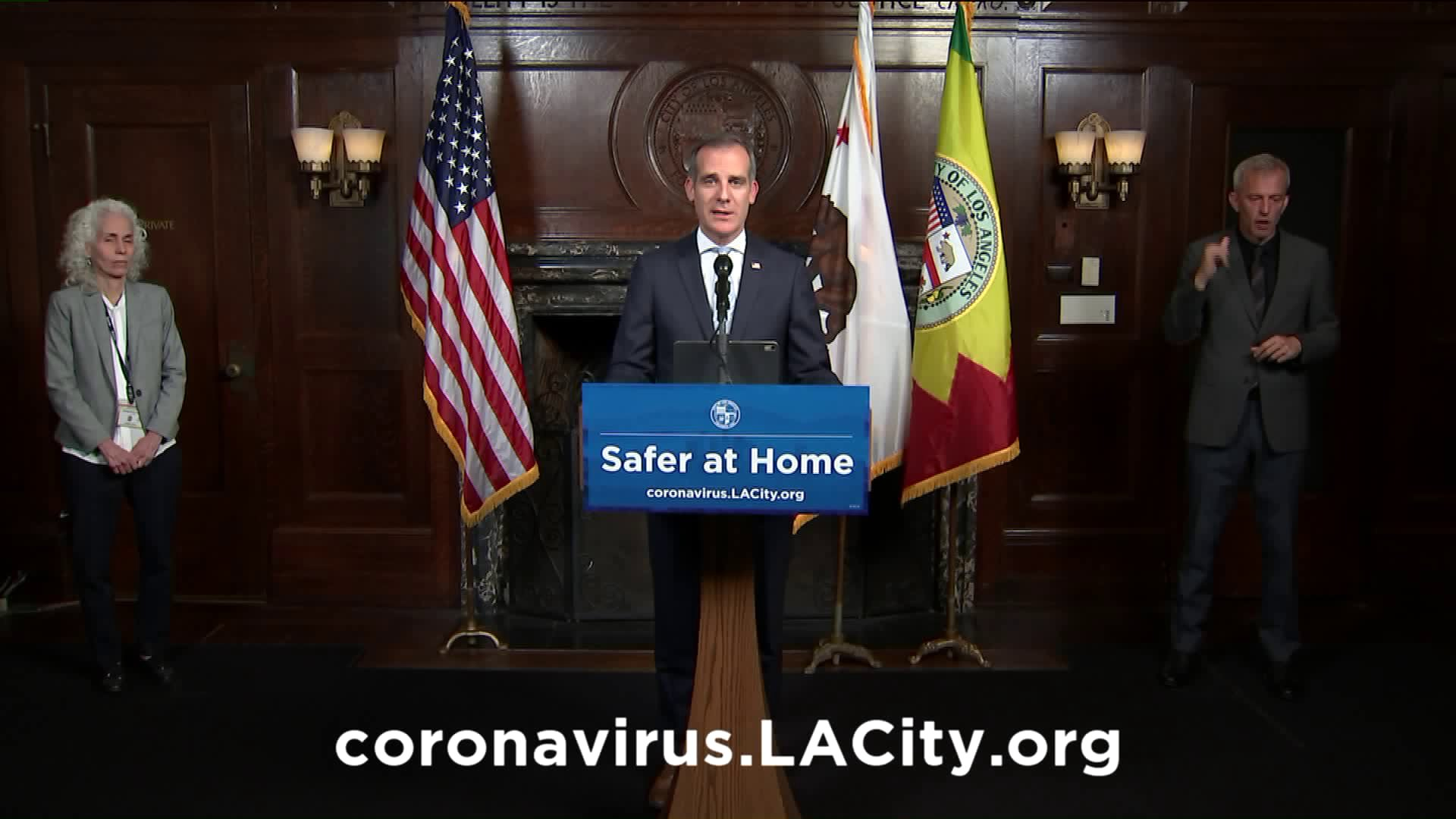 L.A. Mayor Eric Garcetti is seen during a news conference on April 2, 2020, with Dr. Barbara Ferrer, Director of the L.A. County Department of Public Health to his left.
