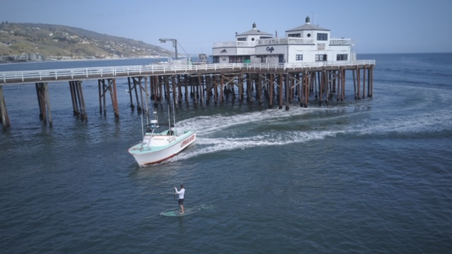 A patrol boat chases down a paddleboarder at the Malibu Pier after he allegedly ignored orders to leave the ocean amid a statewide stay at home order on April 2, 2020, in a photo released by the Los Angeles County Sheriff's Department.