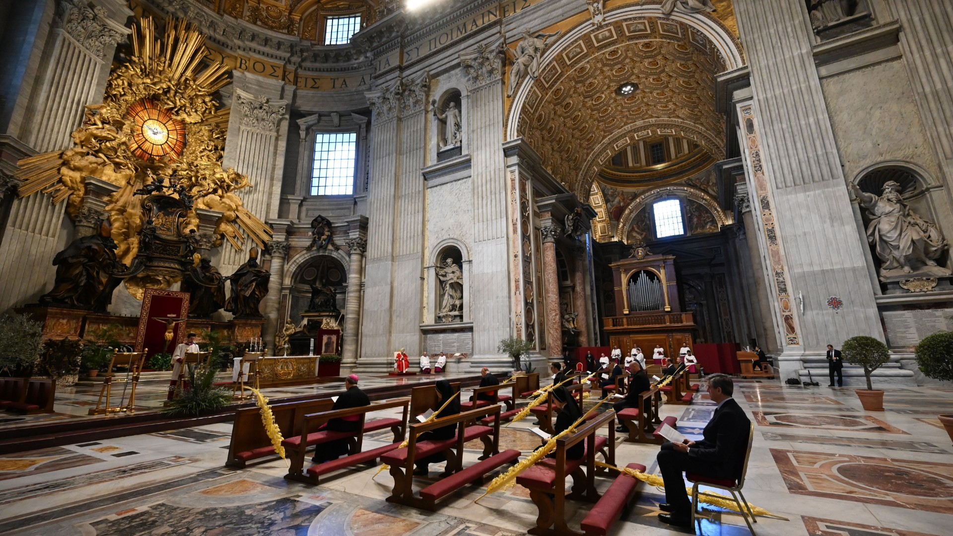 A general view shows Pope Francis (Rear C) and attendees during Palm Sunday mass behind closed doors at the Chair of Saint Peter in St. Peter's Basilica mass on April 5, 2020 in The Vatican, during the lockdown aimed at curbing the spread of the COVID-19 infection, caused by the novel coronavirus. (Alberto Pizzoli/POOL/AFP/Getty Images)