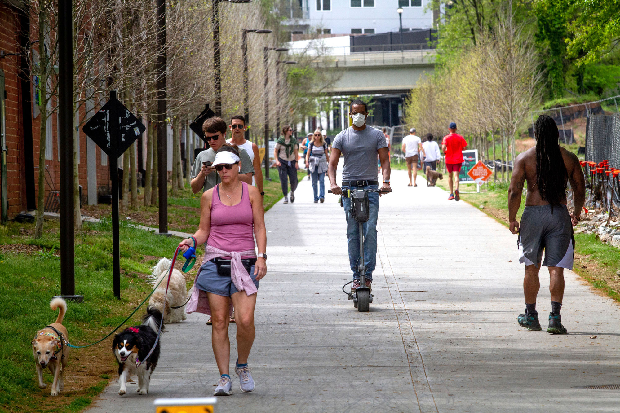 Marcus Bouliany, center, wears a mask while making his way along the BeltLine in Atlanta, during the coronavirus outbreak Saturday, April 4, 2020. (Steve Schaefer/AP)