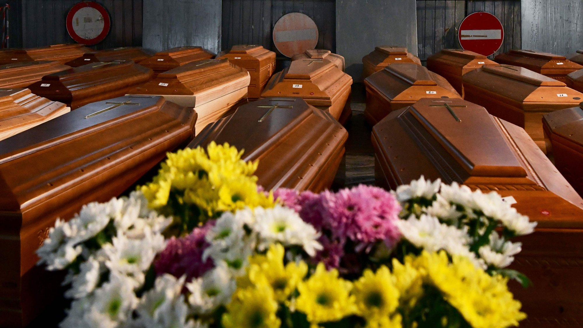 A general view shows some of 35 coffins of deceased people stored in a warehouse in Ponte San Pietro, near Bergamo, Lombardy, on March 26, 2020 prior to be transported in another region to be cremated, during the country's lockdown following the COVID-19 new coronavirus pandemic. (Piero Cruciatti / AFP via Getty Images)