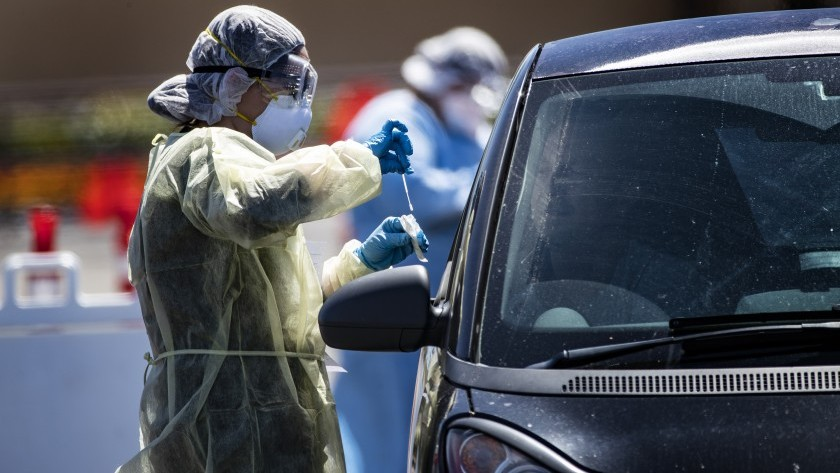 A passenger gets a coronavirus test at a drive-though facility for Coachella Valley residents in the parking lot of the Southwest church in Indian Wells last week. That site was relocated to the Riverside County Fairgrounds in Indio.(Gina Ferazzi/Los Angeles Times)