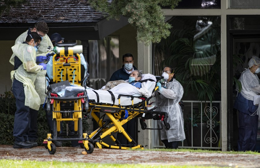A patient is removed from a Riverside nursing home amid a COVID-19 outbreak in this undated photo. Hospice workers, who frequently visit such facilities, face a shortage of protective equipment. (Gina Ferazzi/Los Angeles Times)