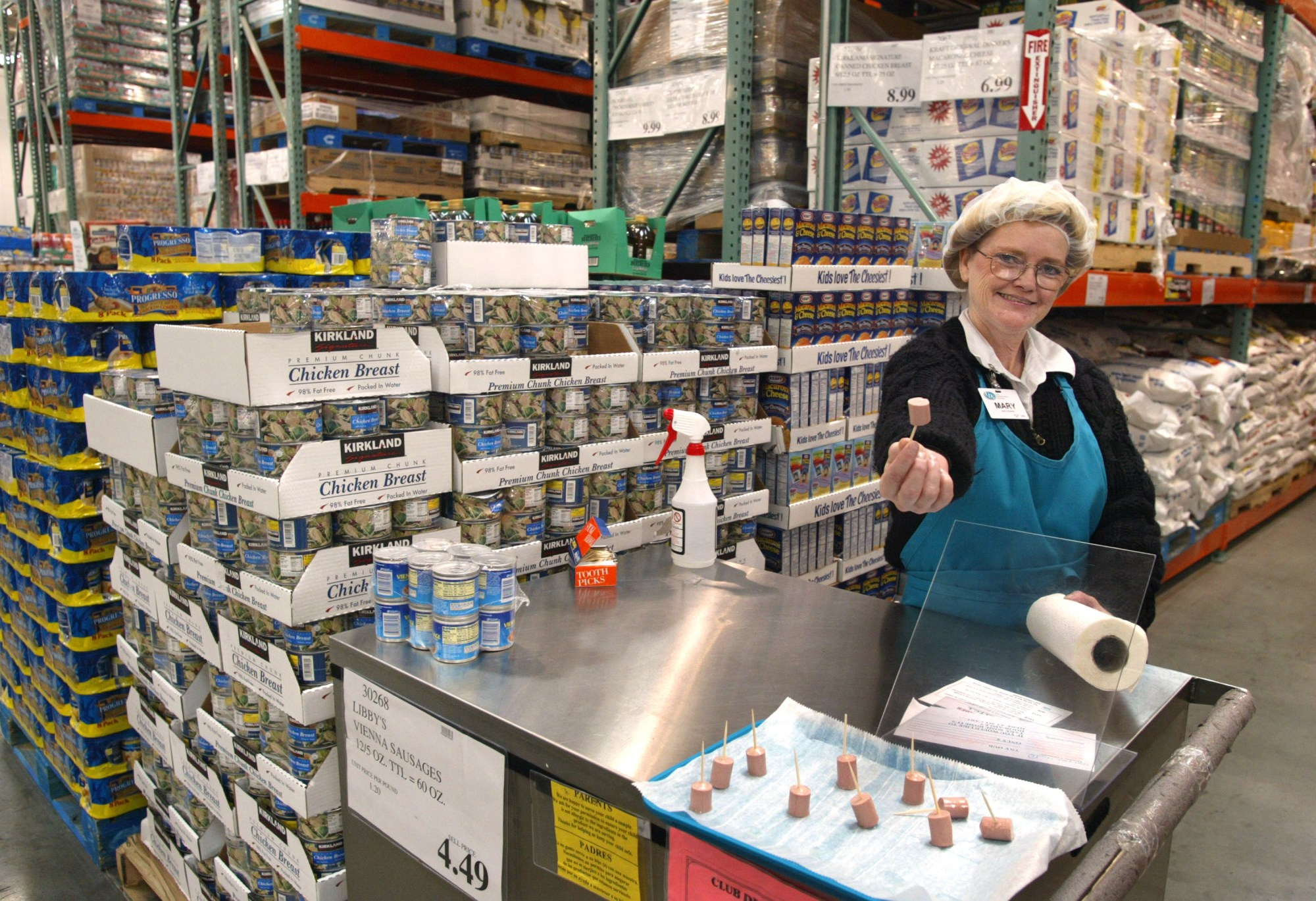 Mary LaRocca offers a sample of Libby's Vienna Sausage in a Costco Wholesale store March 8, 2002 in Niles, Illinois. (Tim Boyle/Getty Images)