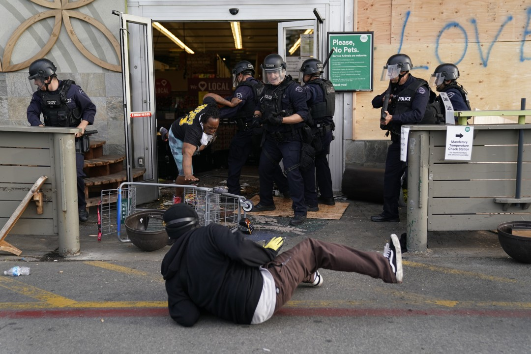 Protester are thrown out of a Whole Foods Market in the Fairfax District of Los Angeles on May 30, 2020. (Kent Nishimura/Los Angeles Times)
