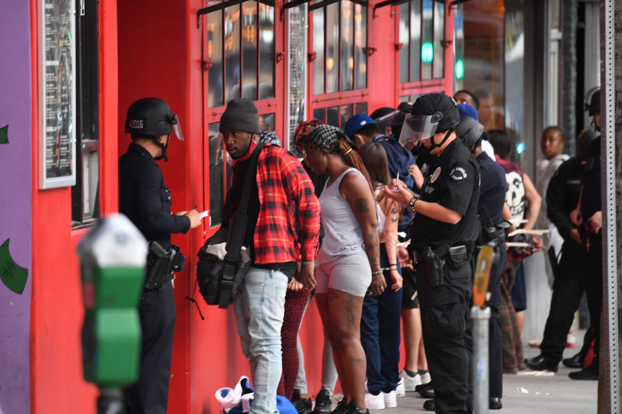 People are arrested in Hollywood on June 1, 2020, as a third night of curfews followed days of massive, mostly peaceful protests to decry George Floyd's death in Minneapolis. (Robyn Beck / AFP via Getty Images)