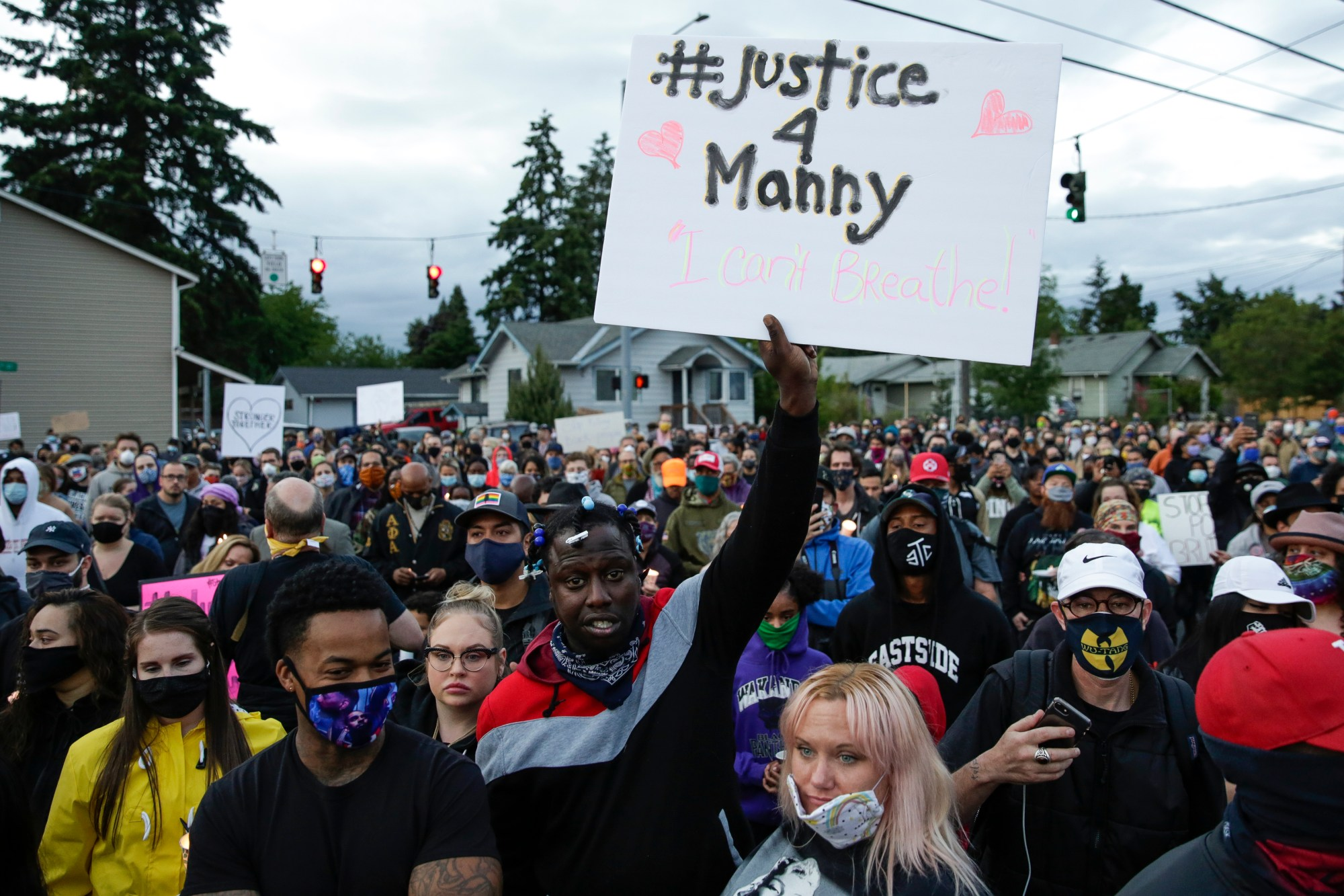Family, friends and community members attend a vigil at the intersection where Manuel Ellis, a 33-year-old black man, died in Tacoma police custody on March 3 after his death was ruled a homicide on June 3, 2020. (Jason Redmond / AFP / Getty Images)