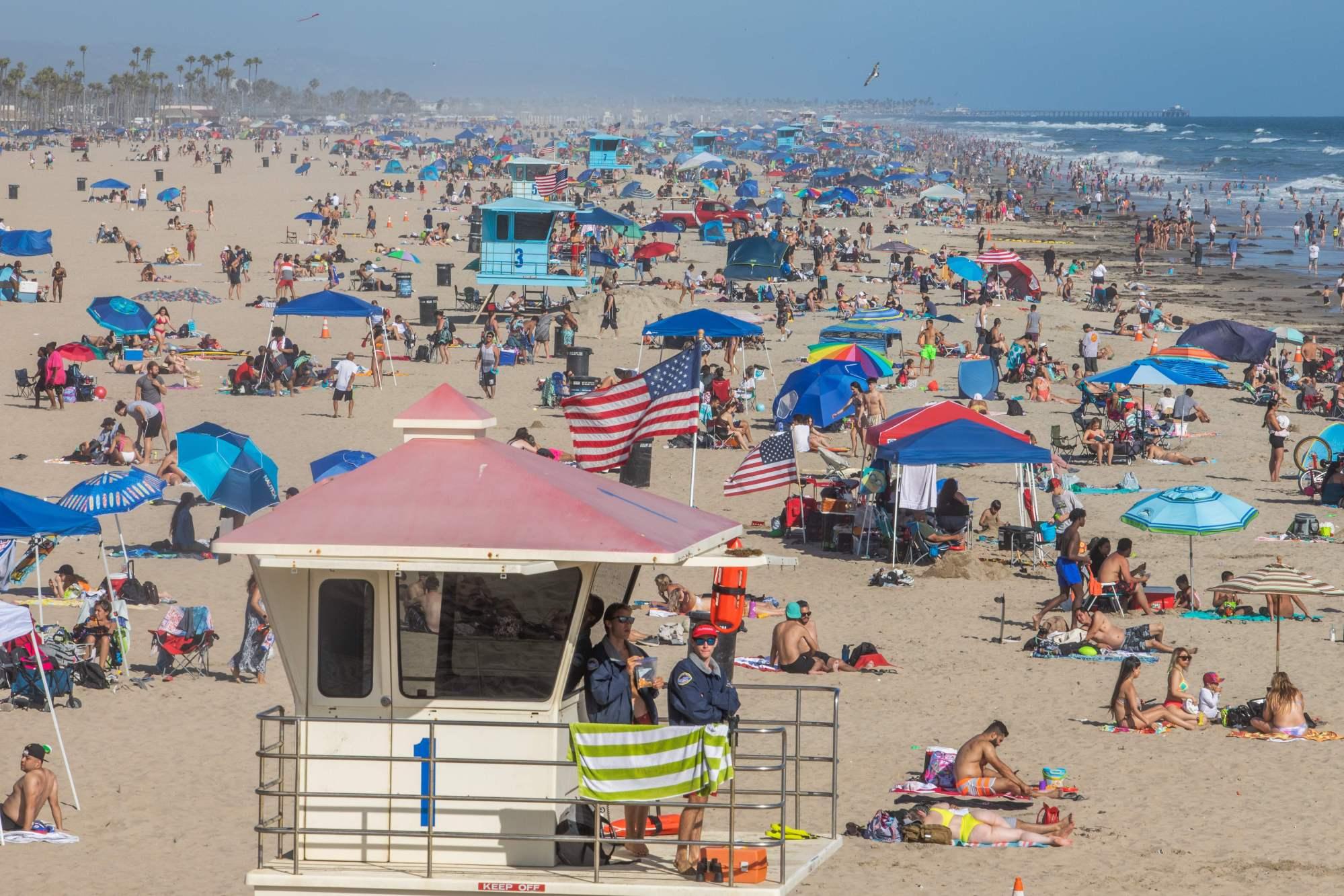 People enjoy the beach amid the coronavirus pandemic in Huntington Beach, on June 14, 2020. (Apu GOMES / AFP) (Photo by APU GOMES/AFP via Getty Images)