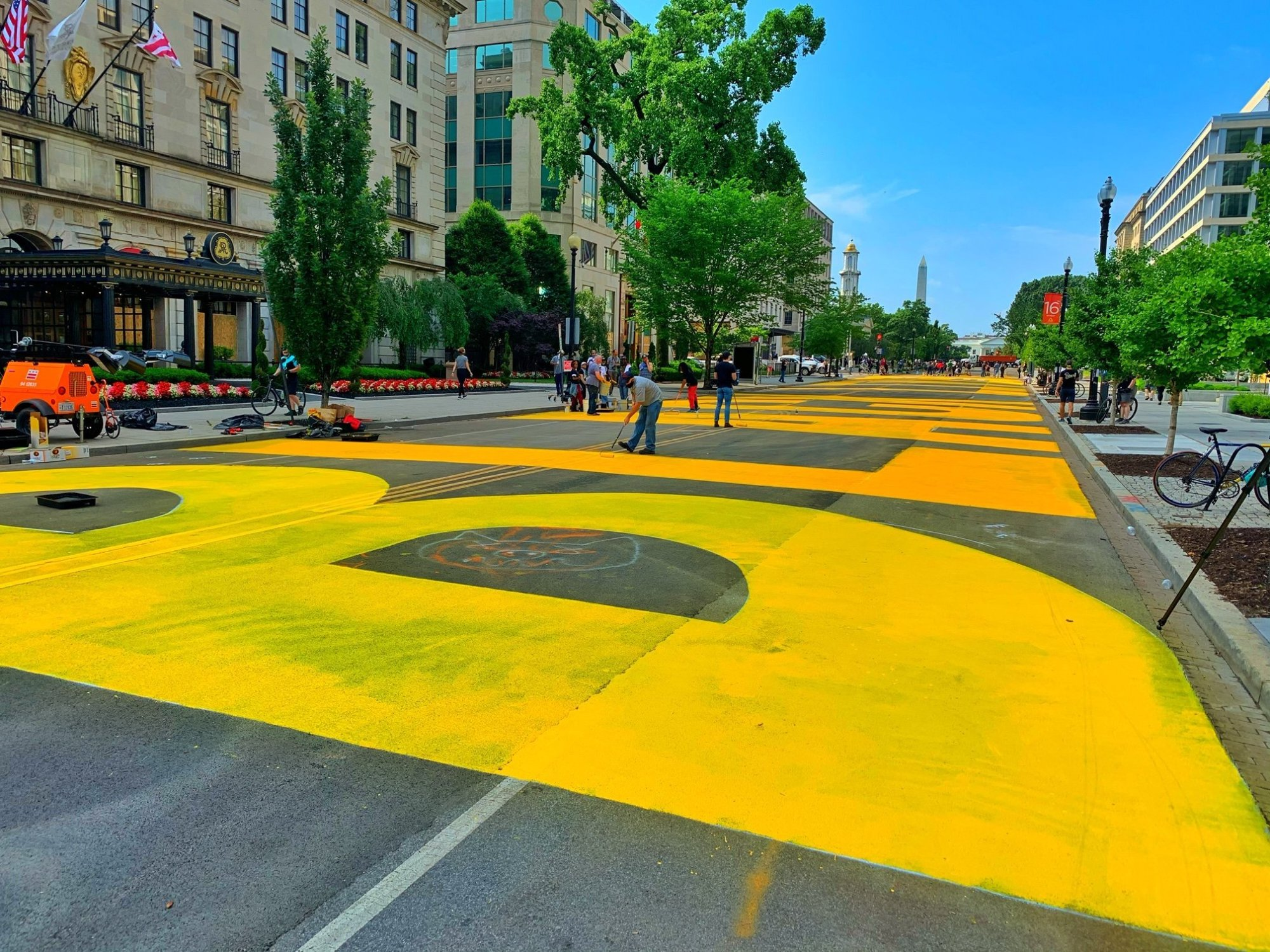 Giant, yellow letters are painted on a busy Washington D.C. street on June 5, 2020, spelling out BLACK LIVES MATTER (CNN)