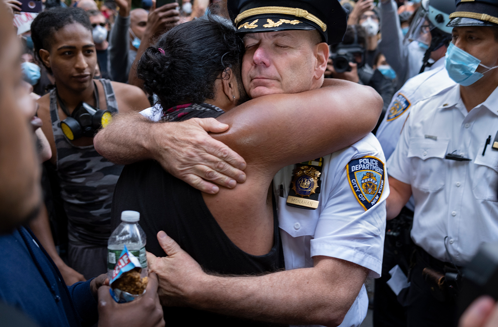 Chief of Department of the New York City Police, Terence Monahan, hugs an activist. (Craig Ruttle/AP via CNN Wire)