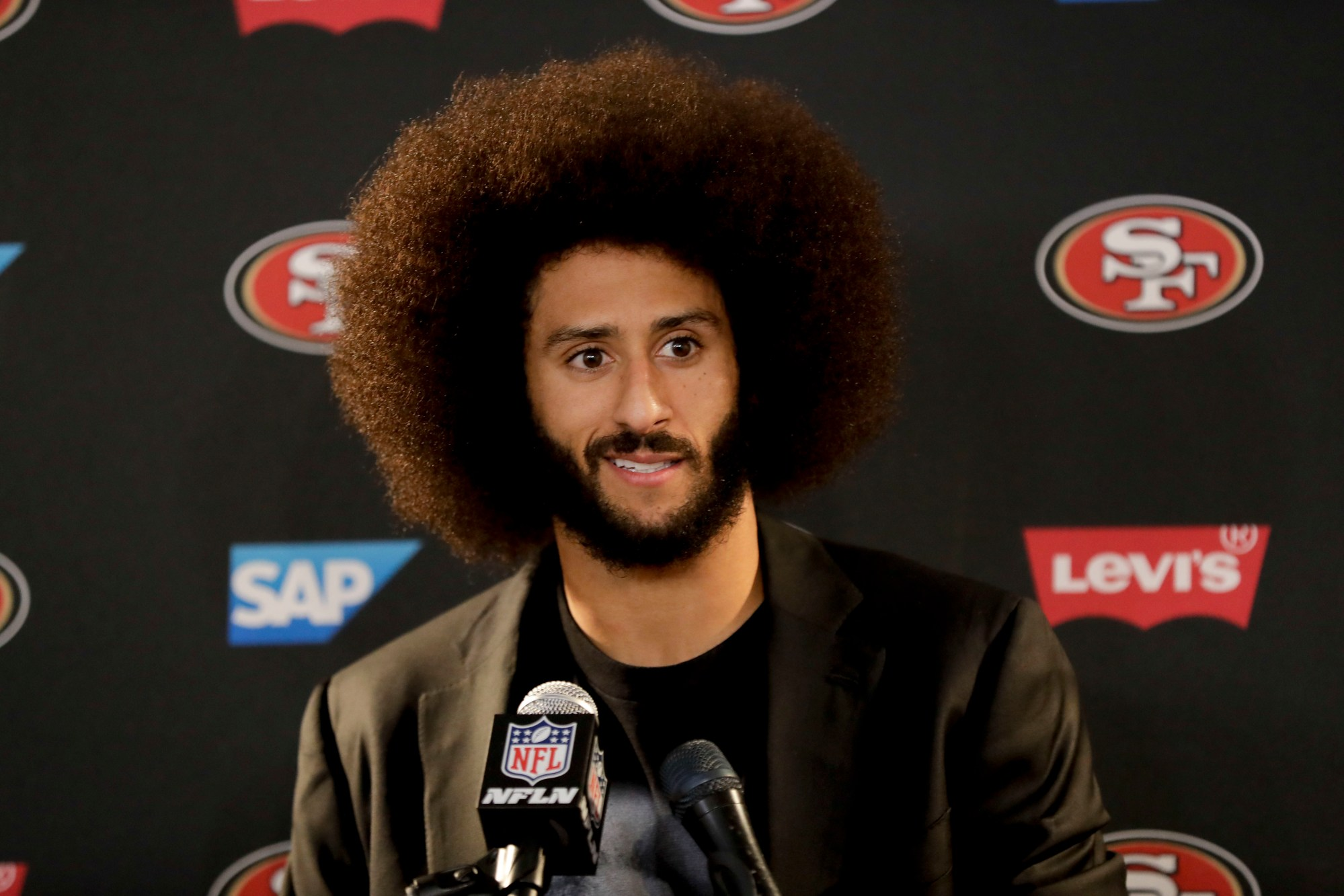 In this Dec. 24, 2016, file photo San Francisco 49ers quarterback Colin Kaepernick talks during a news conference after an NFL football game against the Los Angeles Rams. (AP Photo/Rick Scuteri, File)