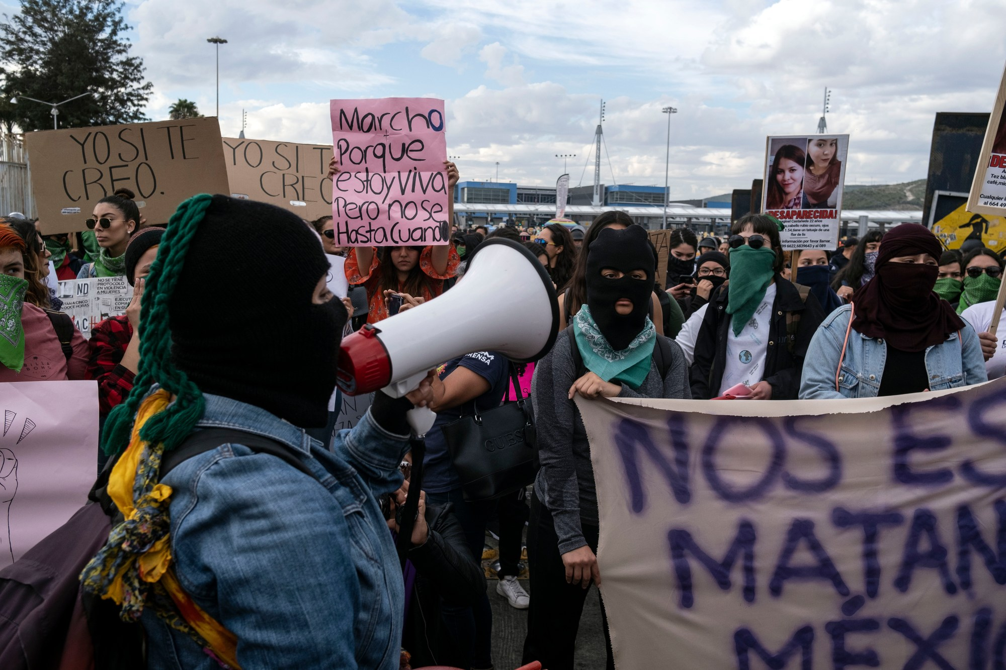Women protest gender violence at the San Ysidro port of entry on the US/Mexico border on February 21, 2020, Tijuana, Baja California state, Mexico. Recent femicide cases in Mexico haveshocked the country, mobilizing women into to protesting gender violence. (GUILLERMO ARIAS/AFP via Getty Images)