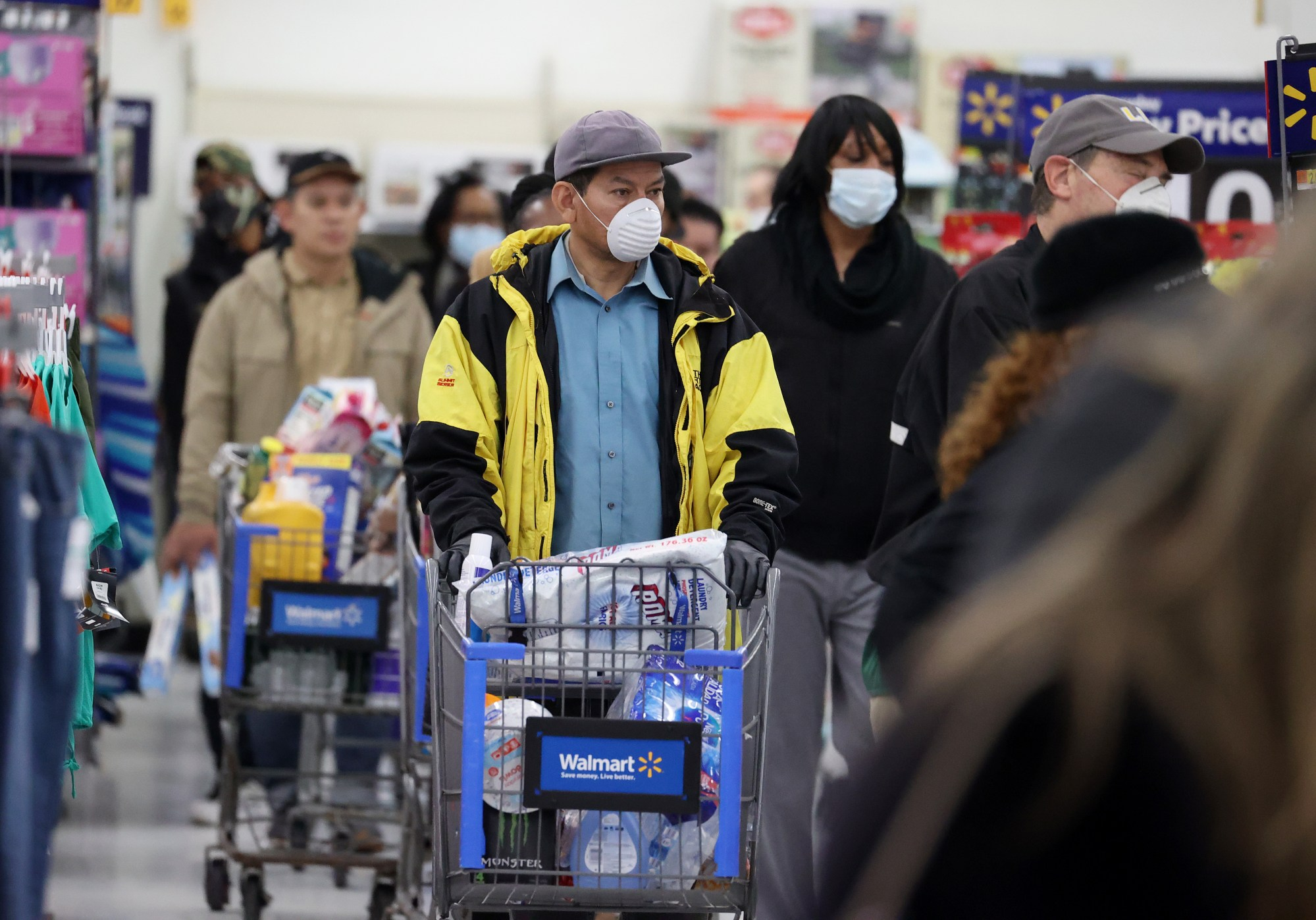 People wearing masks and gloves wait to checkout at Walmart on April 3, 2020, in Uniondale, New York. (Al Bello/Getty Images)