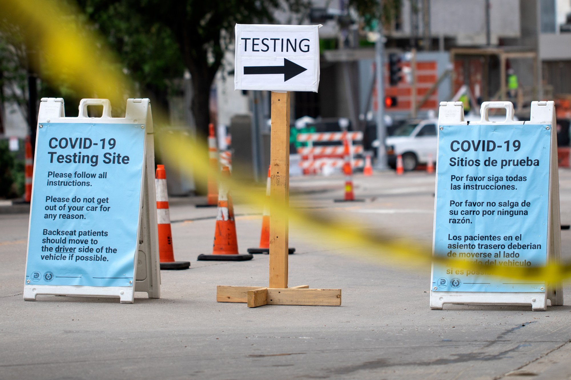 Cars wait in line at a drive up COVID-19 testing site inside the American Airlines Center parking garage in Dallas on June 27, 2020. (Montinique Monroe/Getty Images)