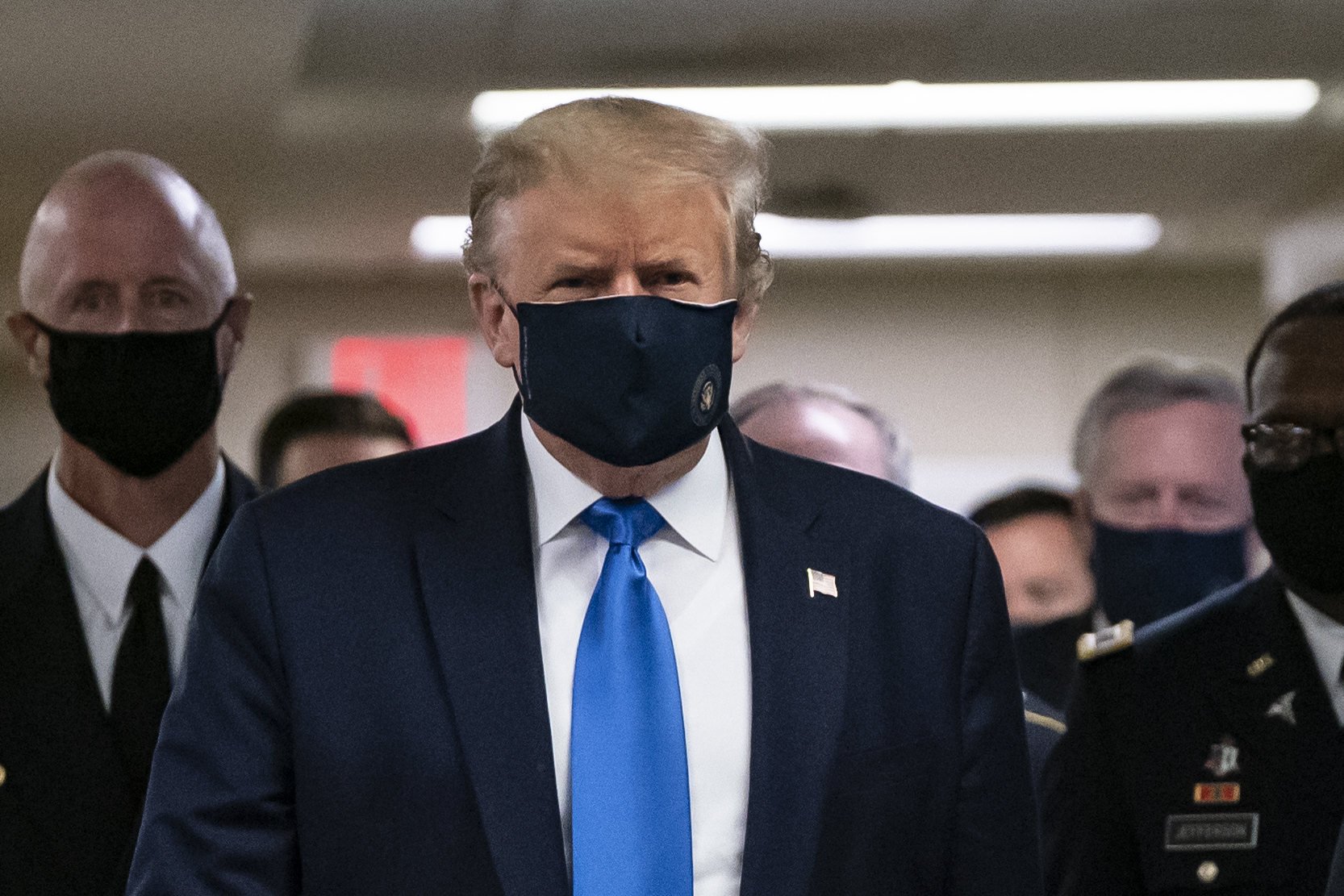 President Donald Trump wears a mask as he visits Walter Reed National Military Medical Center in Bethesda, Maryland on July 11, 2020. (ALEX EDELMAN/AFP via Getty Images)
