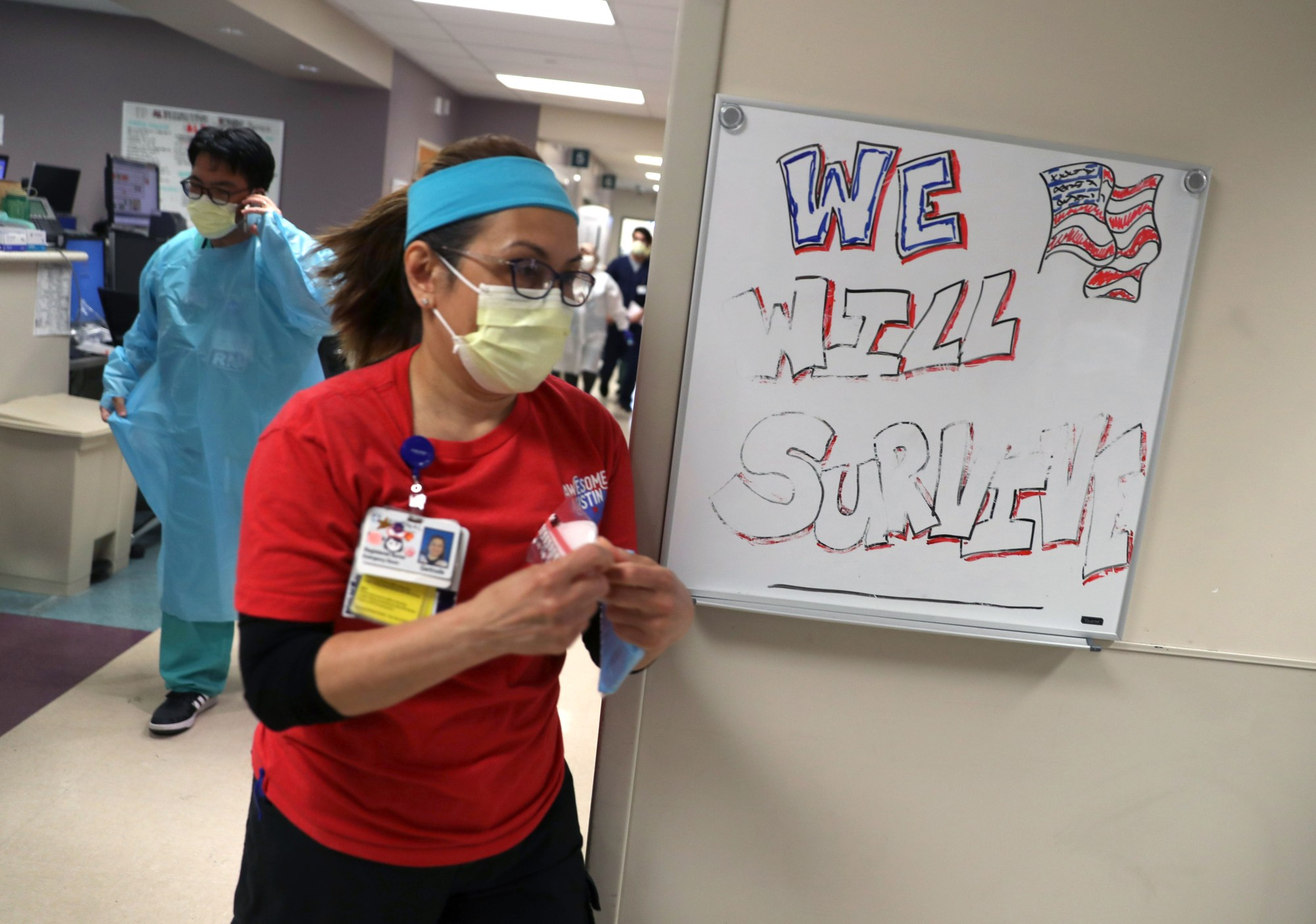 Nurses rush to meet with a patient being admitted to the emergency room at Regional Medical Center on May 21, 2020 in San Jose, California. (Justin Sullivan/Getty Images)