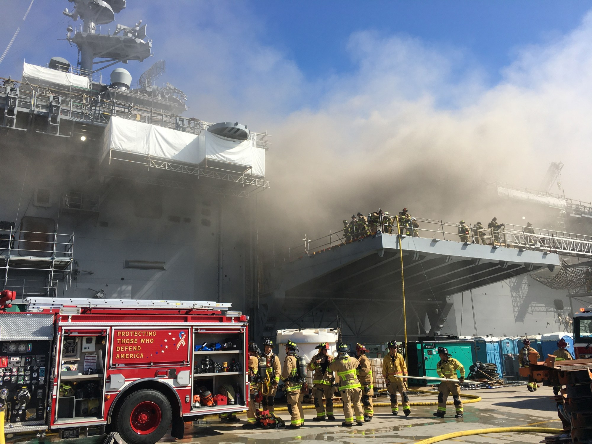 Sailors and Federal Fire San Diego firefighters combat a fire aboard the amphibious assault ship USS Bonhomme Richard (LHD 6), July 12, 2020. (Mass Communication Specialist 1st Class Jason Kofonow/U.S. Navy via Getty Images)